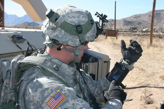 Staff Sgt. Reag Wood of 1st Combined Arms Battalion 5th Brigade 1st Armored Division illustrates how he uses an iphone to obtain a visual image of a mock with insurgent activity during a field training exercise at White Sands Missile Range N.M. (U.S