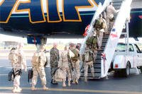 servicemembers boarding jet