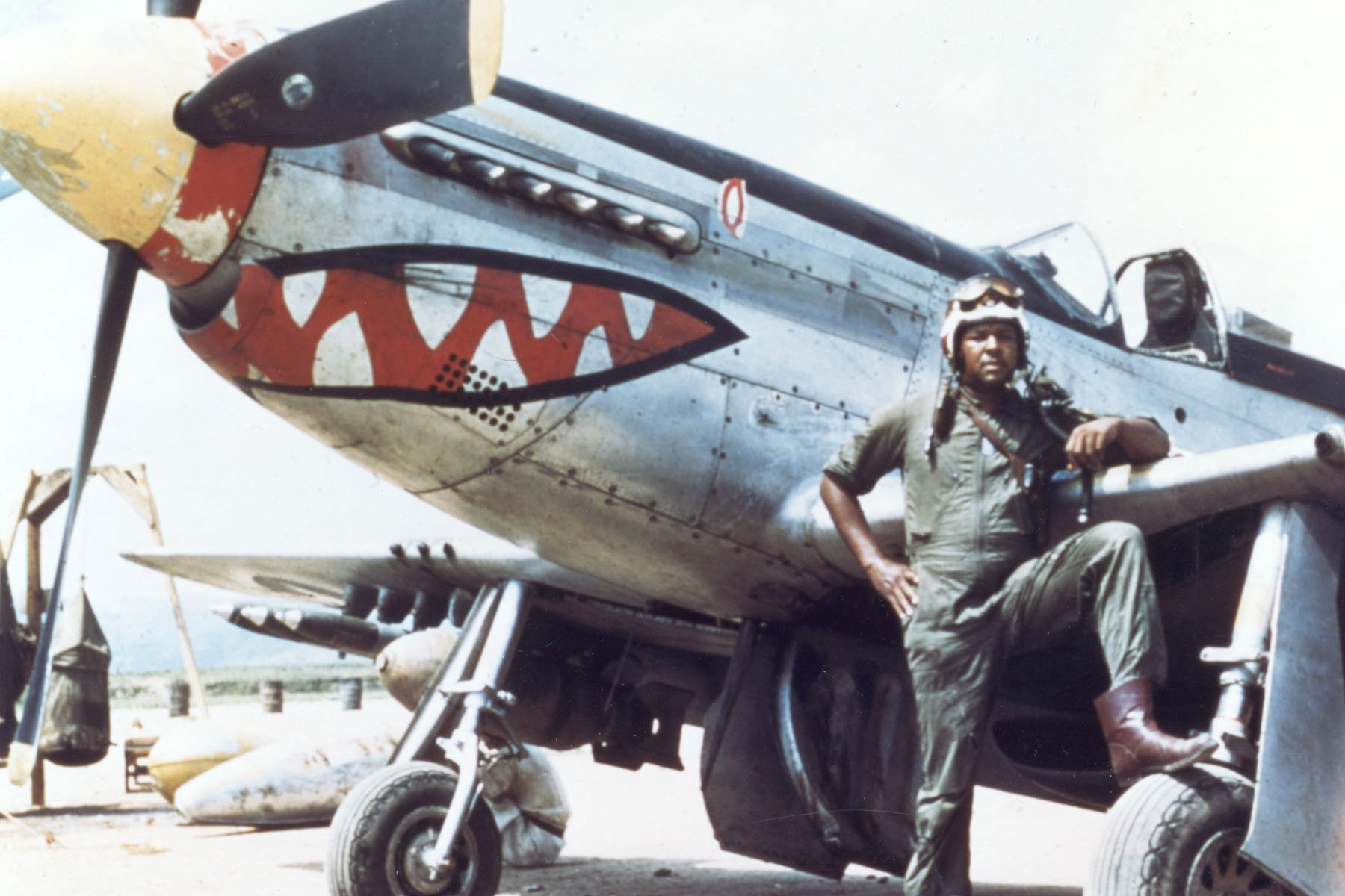 "Daniel ""Chappie"" James Jr., pictured here serving as a fighter pilot with a P-51 during the Korea.War, in 1975 because the first African American to reach the rank of four-star general and died shortly after his retirement in 1978.  His son, Daniel James III, also served in the Air Force and Air National Guard rising to the rank of lieutenant general, and becoming the first African-American to take command as director of the Air National Guard before retiring in 2006.  (U.S. Air Force)"