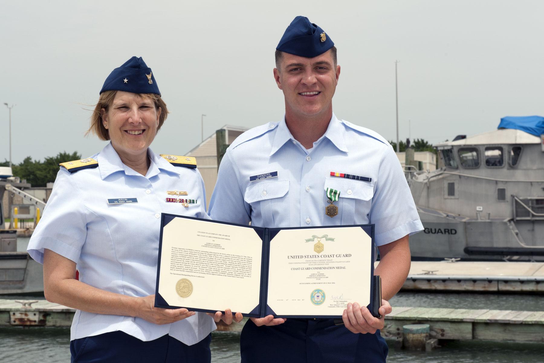 Coast Guardsman Receives Award For Rescuing Women In Pier