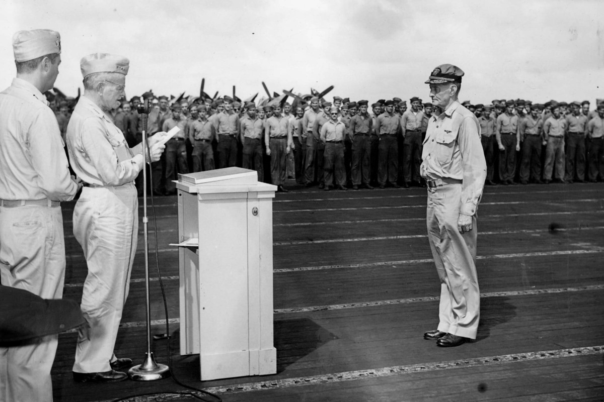 Adm. William Halsey presenting Vice Adm. John McCain with the Navy Cross on the flight deck of USS Hancock, Nov. 30, 1944. (National Museum of Naval Aviation photo)
