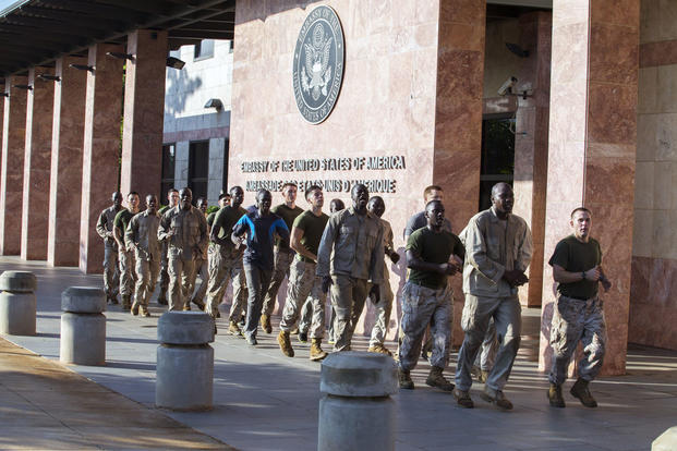 U.S. Marine Corps and other military personnel run during a physical training session outside of the Marine House at the U.S. Embassy, Bamako, Mali, Aug. 29, 2016. (U.S. Marine Corps photo/Staff Sgt. Sarah R. Hickory)