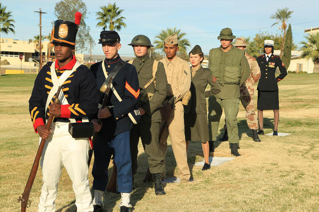 Marines showcase Marine Corps uniforms spanning different time periods. (Photo: U.S. Marine Corps/Lance Cpl. Torrey L. Gray Field)