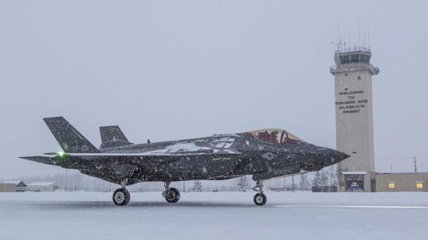 "Maj. Jonathan ""Spades"" Gilber, U.S. Air Force F-35 test pilot, demonstrates the handling qualities of Lockheed Martin's (NYSE: LMT) F-35 Lightning II during icy runway ground testing at Eielson Air Force Base, Alaska. (Photo: Darin Russell, Lockheed Martin)"