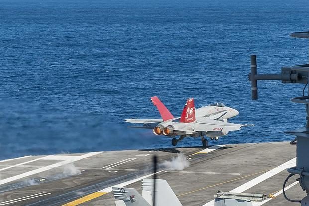 An F/A-18C Hornet attached to Strike Fighter Squadron 37 takes off from the aircraft carrier George H.W. Bush on Oct. 20, 2017. The Navy plans to put a recompression chamber aboard every deploying carrier to combat hypoxia symptoms. Mass Communication Specialist 3rd Class Mario Coto/Navy