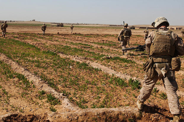 A team of infantry Marines with 3rd Platoon, Charlie Company, 1st Battalion, 9th Marine Regiment, crosses a field during a security patrol in Helmand province, Afghanistan, in 2014. Cpl. Cody Haas/Marine Corps