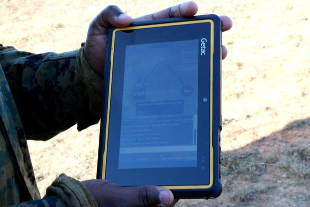 The Marine Corps demonstrated a drone helicopter called the Autonomous Aerial Cargo/Utility System, or AACUS, on Dec. 13, 2017, at Quantico, Va. A marine on the ground uses a tablet to request the resupply mission. (Military.com photo by Matthew Cox)