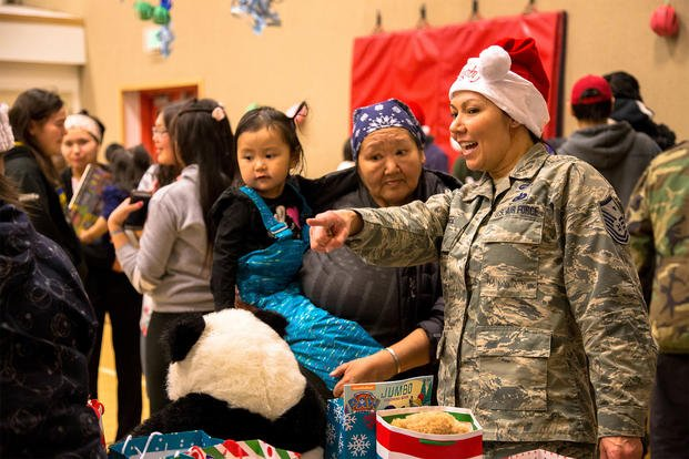 Alaska National Guard members and volunteers visit with children of St. Michael, Alaska, during Operation Santa Claus Dec. 5, 2017. (U.S. Army National Guard/Marisa Lindsay)