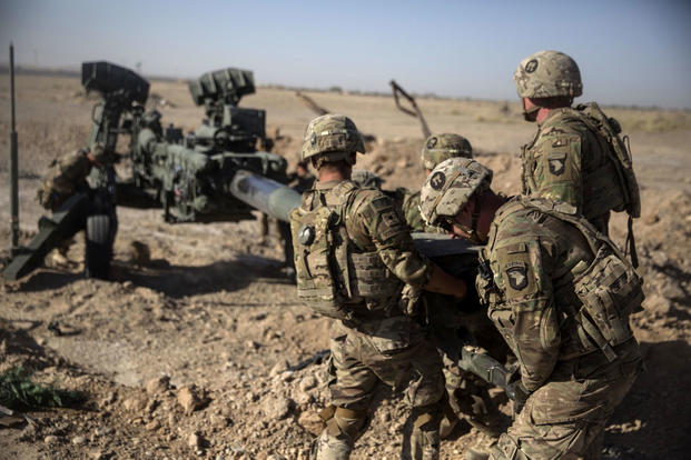 Army soldiers maneuver a howitzer in Afghanistan. U.S. troops have occasionally come under scrutiny for acting on their own to stop child abuse in the country. (US Marine Corps photo/Justin Updegraff)