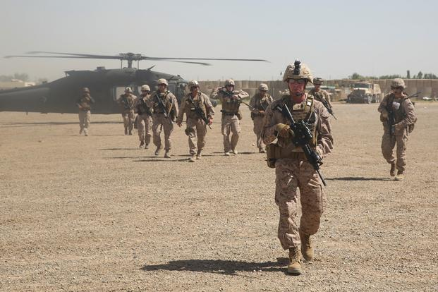 U.S. Marines with Task Force Southwest depart a UH-60 Blackhawk helicopter prior to an advisory meeting with Afghan National Army soldiers at Camp Hanson, Afghanistan, June 13, 2017. (U.S. Marine Corps photo)