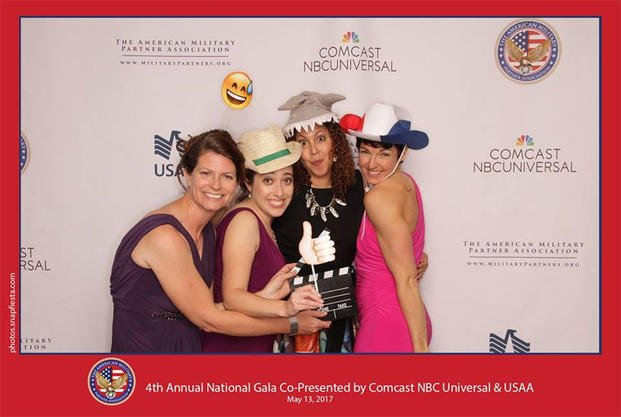 Military.com's Amy Bushatz, far right, poses at a photo booth with other military spouses at the 2017 American Military Partner Association gala. (American Military Partner Association)