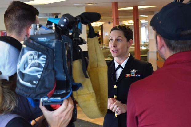 Navy Lt. Cmdr. Erika Schilling, a nurse midwife at Naval Hospital Bremerton, Wash., is interviewed by radio and television reporters in Seattle, Jan. 18, 2018. (U.S. Navy/Douglas H Stutz)