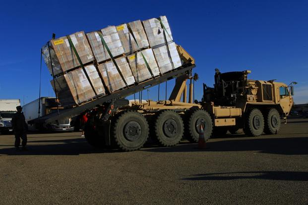 FILE PHOTO -- U.S. Army National Guard Soldiers load pallets of food onto a palletized loading system Thurs., Dec. 7, 2017, at Joint Forces Training Base Los Alamitos, California. (U.S. Air National Guard/Senior Airman Crystal Housman)
