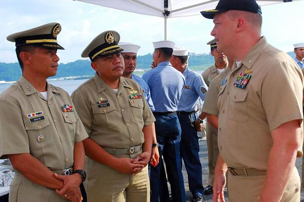 "Former Navy Cmdr. Troy Amundson, right, shown speaking with members of the Philippine navy in Subic Bay in 2010, pleaded guilty to a federal bribery charge as part of the ongoing ""Fat Leonard"" scandal on Jan. 30, 2018. Jessica Bidwell/Navy"