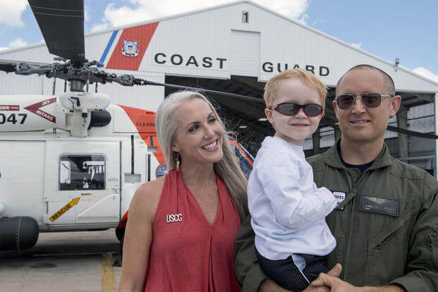 The 2017 Armed Forces Insurance Coast Guard Spouse of the Year, Mary Nelson, poses for a photo with her son Wyatt, 4, and husband, Petty Officer 1st Class James Nelson at Air Station Clearwater, Florida. (U.S. Coast Guard/Michael De Nyse)