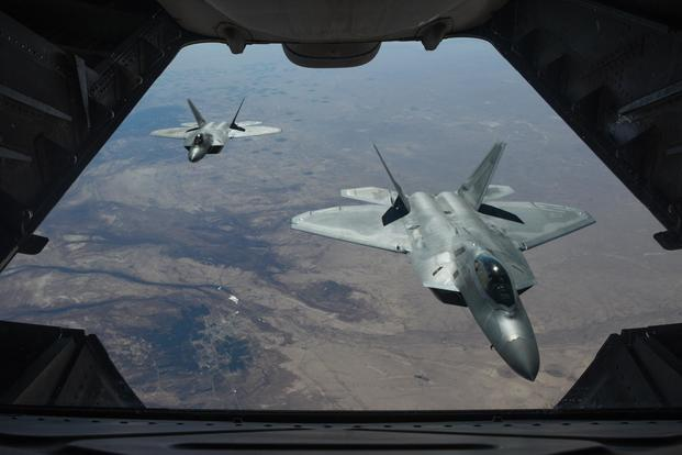 FILE -- Two U.S. Air Force F-22 Raptors fly above Syria in support of Operation Inherent Resolve, Feb. 2, 2018. (U.S. Air National Guard/Staff Sgt. Colton Elliott)