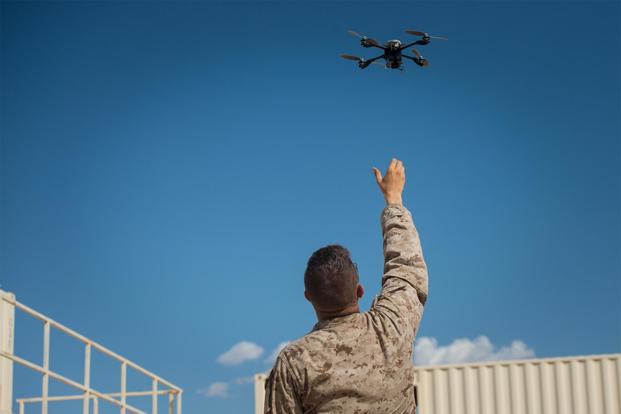"A Marine with Kilo Company, 3rd Battalion, 5th Marine Regiment, assists his squad by providing reconnaissance with an ""Instant Eye"" unmanned aerial system at Marine Corps Air Ground Combat Center Twentynine Palms, Calif., July 31, 2016. (US Marine Corps photo)"