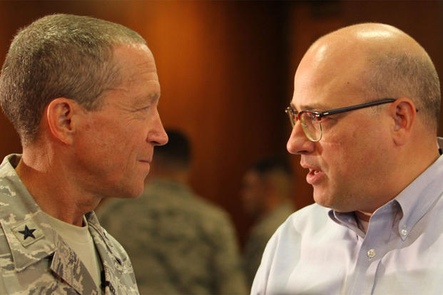 Investor and businessman, Charles Von Thun of Denver, discusses professional credentialing with U.S. Air Force Brig. Gen. Paul Ayers of Leesburg, Va., after a meeting of the Guard and Reserve Network, (U.S. Air Force photo / Scot Talcott)