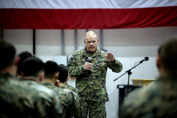 General Robert Neller, Commandant of the Marine Corps, speaks to Marines at Naval Air Station Sigonella, Italy. He recently spoke to Marine units stationed in nine countries. (US Marine Corps photo/Alexander Mitchell)