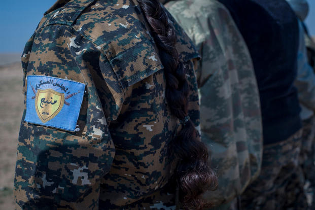 The patch worn by a member of the Manjib Military Council at Sanaa Training Center in northwest Syria. The group is a multi-ethnic force that includes Kurds, Arabs, Christians and Turkmen. (US Army photo/Mark Burrell)