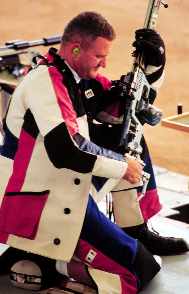 Capt. Glenn A. Dubis prepares to shoot from the kneeling position during qualifications for the Men's 50 meter rifle three position at the 2000 Olympic Games in Sydney.