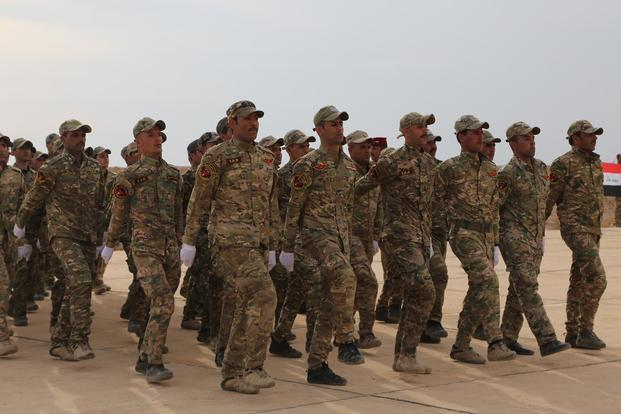 Soldiers with the Desert Battalion, Iraqi army, march in formation as the graduation ceremony begins at Al Taqaddum, Iraq, Feb. 15, 2018. (U.S. Army/Spc. Shannon Westpfahl)