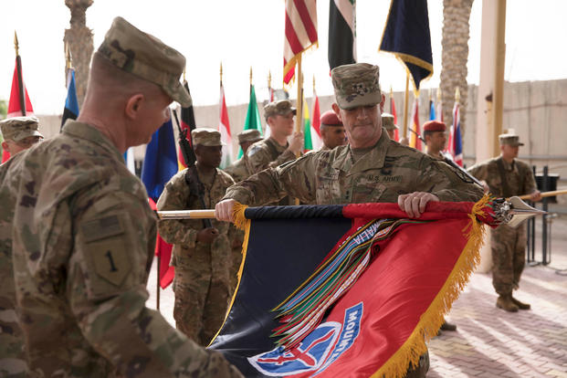 Maj. Gen. Walter Piatt, incoming commanding general of Combined Forces Land Component Command -- Operation Inherent Resolve and 10th Mountain Division and Fort Drum, New York, and Command Sgt. Maj. Samuel J. Roark uncase their division colors during the transfer of authority ceremony for the Combined Forces Land Component Command -- Operation Inherent Resolve in Baghdad, Iraq, March 19, 2018. (U.S. Army photo/Michael Reinsch)