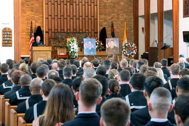 Rear Adm. Roy Kelley, Commander, Naval Air Force Atlantic, addresses friends, family and squadron mates at a March 30 memorial service for Lt. Cmdr. James Brice Johnson and Lt. Caleb King. (US Navy photo/Christopher Lindahl)