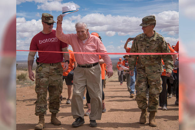 100-year-old Bataan Death March survivor Col. Ben Skardon, a beloved Clemson University alumnus and professor emeritus, crosses the 8.5-mile finish line of the Bataan Memorial Death March at White Sands Missile Range, N.M., March 25, 2018. (Photo: U.S. Army/Ken Scar)