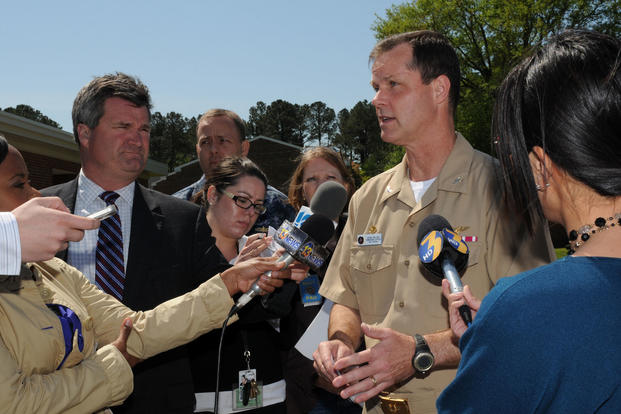 Capt. Bob Geis, then the commanding officer of Naval Air Station Oceana, is interviewed by members of the Hampton Roads media during the Navy's distribution of emergency funds to residents of the Mayfair Mews Apartments who were affected by the April 6, 2012 crash of an F/A-18D Hornet, April 9, 2012. (U.S. Navy photo/Antonio Turretto Ramos)