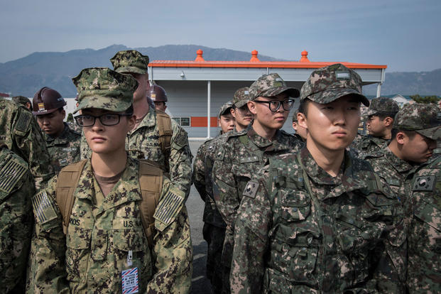 Naval Mobile Construction Battalion 5 Sailors and Republic of Korea (ROK) sailors listen to a safety brief at the ROK Naval Education and Training Command in Jinhae, ROK, March 13, 2017, as part of exercise Foal Eagle 2017. (U.S. Navy photo/Torrey W. Lee)