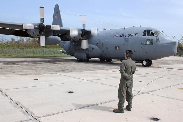 Airman 1st Class Edwin Ocasio observes engine start-up prior to a C-130 Hercules mission at Muniz Air National Guard Base, Puerto Rico, Oct. 18, 2017. (U.S. Air National Guard/Tech. Sgt. Dan Heaton)