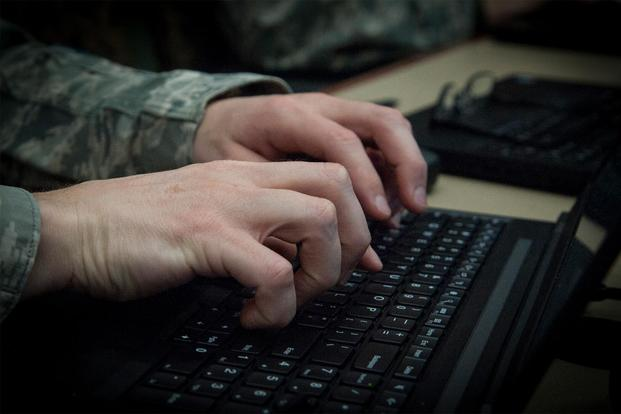 An Airman types on his computer at MacDill Air Force Base, Fla., March 9, 2018. (U.S. Air Force/Senior Airman Mariette Adams)