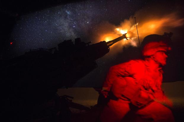 FILE PHOTO -- A U.S. Marine fires an M777-A2 Howitzer in the early morning in Syria, June 3, 2017. (U.S. Marine Corps photo by Sgt. Matthew Callahan)