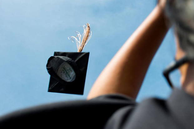 A graduation cap is thrown in the air at the conclusion of a commencement ceremony. (DoD photo/D. Myles Cullen)