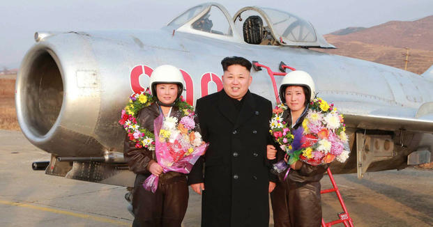 Kim Jong Un with aircraft and women