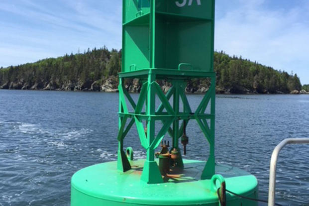The space in which a sound-signaling brass bell typically hangs on this offshore buoy is empty after the bell was stolen, off the coast of Maine. Stealing a sound signaling device off a buoy is a federal offense and can be punishable with heavy fines or even imprisonment. (U.S. Coast Guard courtesy photo)