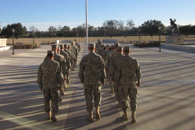 Officer Candidates Move Forward To Lower The Flag That Flies Above Fort  Benning At The End