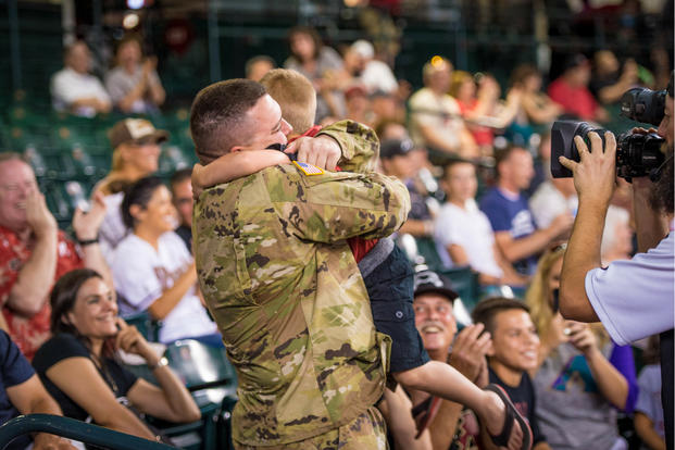 A soldier surprises his family after a year long deployment at an Arizona Diamondbacks game in Phoenix Arizona in 2017. (U.S. Air Force/Jensen Stidham)