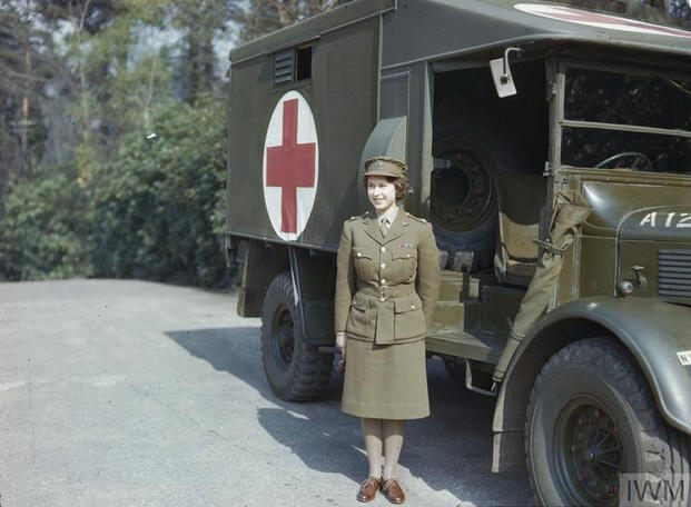 Princess Elizabeth, a 2nd Subaltern in the ATS standing in front of an ambulance. (Imperial War Museum)