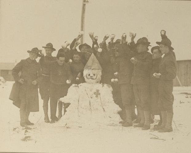 Troops at Camp Upton on Long Island, New York, pose with their snowman of the kaiser. (Photo: National Archives and Records Administration)
