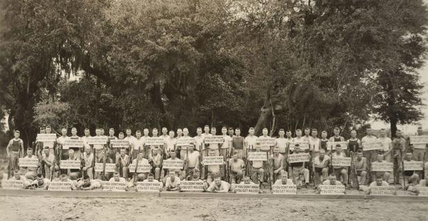 "The Marine Corps bayonet instructors at a school pose for a group photo. The instructors' motto is ""If you don't know, you get killed."" (Photo: National Archives and Records Administration)"