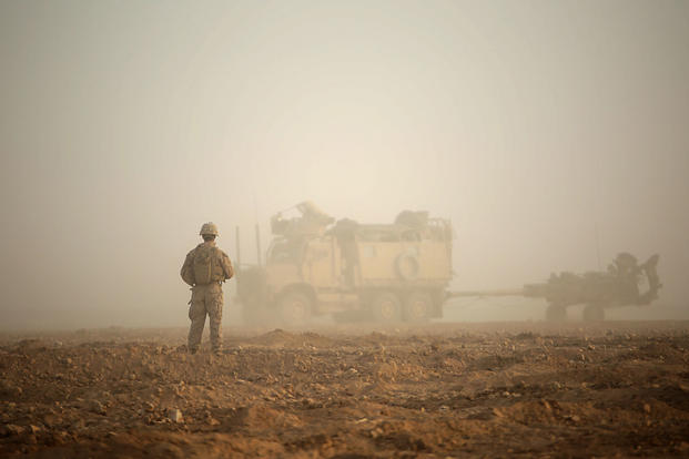 A Marine guides troop movement to a firing position in Syria. Military leaders were unable to determine whether a shooting there was an insider attack or negligent discharge. (Sgt. Matthew Callahan/Marine Corps)