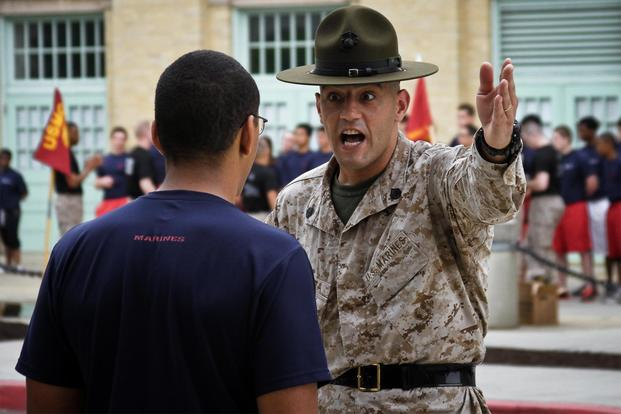 Staff Sgt. Dale R. Barbitta, a drill instructor at the United States Naval Academy, talks to a poolee from Marine Corps Recruiting Station Baltimore during their statewide pool function at the USNA. (U.S. Marine Corps/Cpl. Bryan Nygaard)