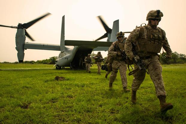 U.S. Marine Lance Cpl. Joshua Ewald, right, a member of Special-Purpose Marine Air-Ground Task Force Crisis Response-Africa, runs off an MV-22B Osprey during a training mission outside Accra, Ghana, April 13, 2015. (U.S. Marine Corps/Sgt. Paul Peterson)