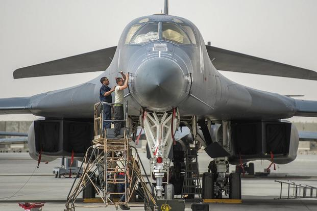 Crew chiefs prepare a B-1B Lancer on Al Udeid Airbase, Qatar, for combat operations against Islamic State of Iraq and the Levant terrorists, April 8, 2015. (U.S. Air Force/Senior Airman James Richardson)