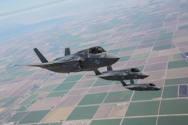 Three F-35B Lightning II Joint Strike Fighters with Marine Fighter Attack Squadron 121, 3rd Marine Aircraft Wing, fly in formation during fixed-wing aerial refueling training over eastern California, Aug. 27. (U.S. Marine Corps/Lance Cpl. Raquel Barraza)