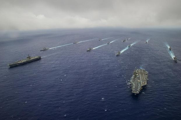 Ship's from the George Washington and Carl Vinson Carrier Strike Groups are underway in formation at the conclusion of Valiant Shield 2014 (U.S. Navy/Mass Communication Specialist 3rd Class Paolo Bayas)