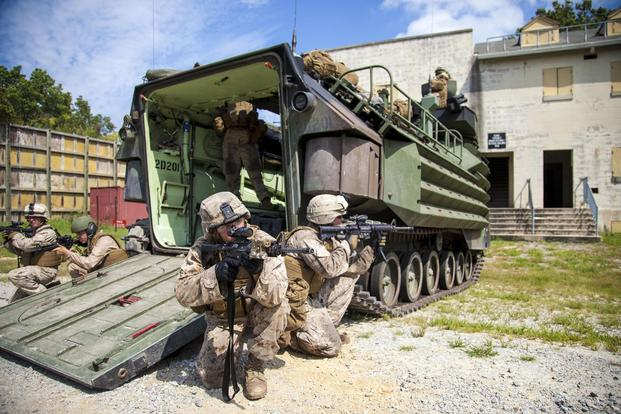 Marines assigned to Battalion Landing Team (BLT) 3/2, 26th Marine Expeditionary Unit (MEU), provide security during a direct action raid from an amphibious assault vehicle at Fort Pickett, Va., Sept. 8, 2012. (U.S. Marines/