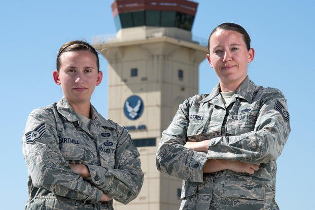 U.S. Air Force Tech. Sgt. Sarah Cartmill, right, 60th Maintenance Squadron and Staff Sgt. Kelsey Cartmill, 60th Air Mobility Wing, pose for a photo at Travis Air Force Base, Calif., September 25, 2018. The duel military same-sex couple has been married for five years. (U.S. Air Force/Louis Briscese)